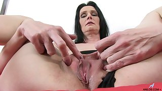 Video of mature slut Laura Dark playing with a large purple dildo