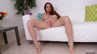 Video of busty mature Jessica Rayne having some fun with a dildo