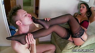Bossy mistress in red-hot shoes stomping on her submissive man
