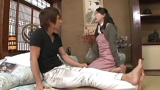 Japanese MILF with long hair and hairy cunt being fucked hard