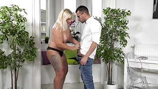 Adult blonde Anna Valentina drops on her knees to make him hard